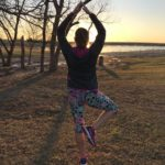 Louellen doing yoga at sunset overlooking the lake at Little Elm Park.