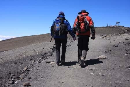 Duane and Louellen approaching Uhuru Peak, Mt. Kilimanjaro, Tanzania.
